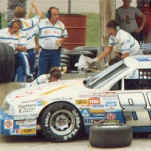 John Suggs, team manager for Buddy Baker, during pit stop at race