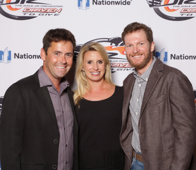Brandon Suggs and Jill Suggs with Dale Earnhardt Jr. at Driven to Give charity event
