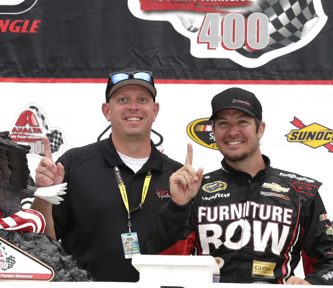 SSM team member Blaine Sellers with Martin Truex in Victory Lane
