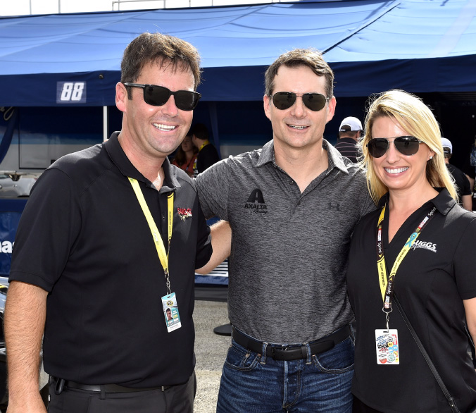Members of the Suggs Sports Marketing team with Jeff Gordon during pre-race